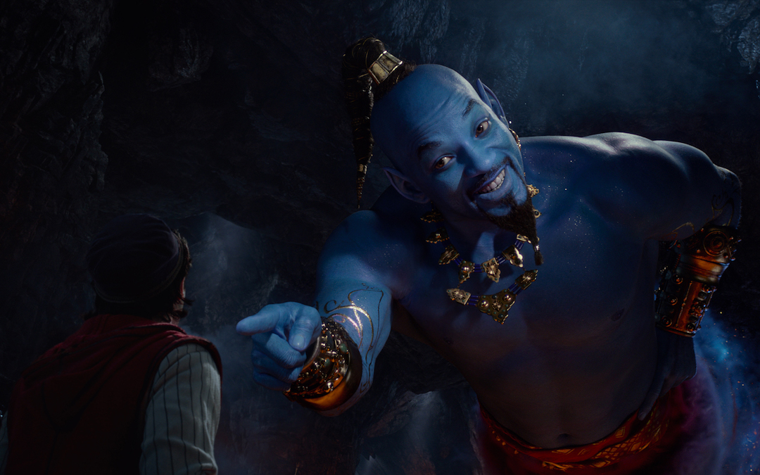 Aladdin (Mena Massoud) meets the larger-than-life blue Genie (Will Smith) in Disney's live-action adaptation ALADDIN, directed by Guy Ritchie.